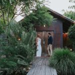 Bride and Groom outside doorway