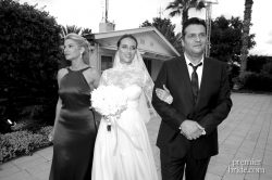 Bride walked down the aisle by her parents